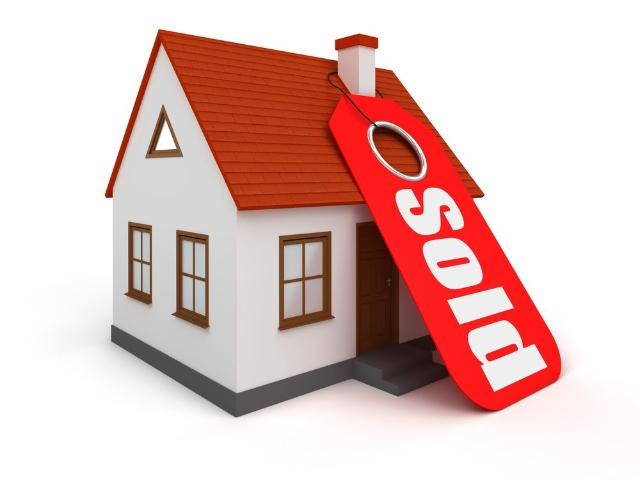 home-with-sold-sign.jpg.gallery