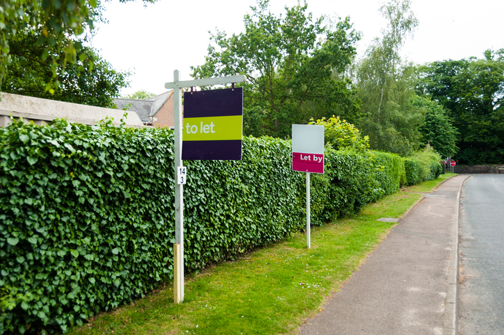 Estate agent sign to Let, and Let by