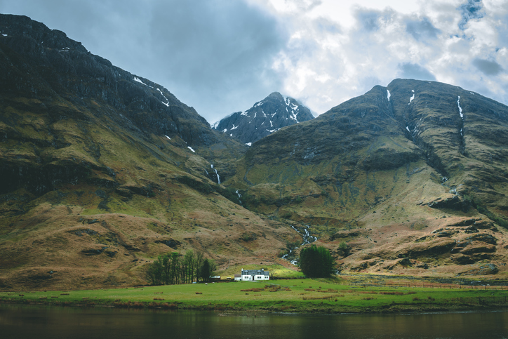 Isolated white house in the Glencoe Valley, Scotland